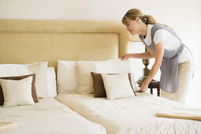Maid Making Beds