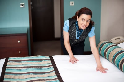 House maid making bed